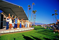 People stand together during a concert at the Alexander & Baldwin Amphitheater at the Maui Arts and Cultural Center in Kahului.