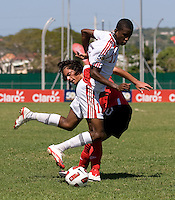 Keven Aleman (10) of Canada fights for the ball with Kiel Pierre (17) of Trinidad & Tobago during the quarterfinals of the CONCACAF Men's Under 17 Championship at Catherine Hall Stadium in Montego Bay, Jamaica. Canada defeated Trinidad & Tobago, 2-0.