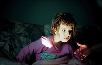 """Ashley Jess,a 10 year old who has been deaf and blind since birth, prefers to sleep on the couch at night, unaffected by the television her grandmother watches.  Her mother says of her life with Ashley, """"With a deaf- blind child you are forced to stop, listen, see, and feel things.  You'd be amazed at what you learn."""""""