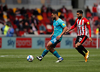 22nd May 2021; Brentford Community Stadium, London, England; English Football League Championship Football, Playoff, Brentford FC versus Bournemouth; Cameron Carter-Vickers of Bournemouth passing the ball into midfield while being marked by Saman Ghoddos of Brentford