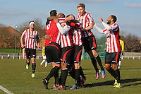 Kieron St Aimie scores the winning goal for Hornchurch and celebrates with his team mates - AFC Hornchurch vs Bromley - Blue Square Conference South Football at The Stadium, Upminster Bridge, Essex - 01/04/13 - MANDATORY CREDIT: Gavin Ellis/TGSPHOTO - Self billing applies where appropriate - 0845 094 6026 - contact@tgsphoto.co.uk - NO UNPAID USE.