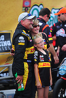May 1, 2011; Baytown, TX, USA: NHRA funny car driver Jeff Arend celebrates with his family after winning the Spring Nationals at Royal Purple Raceway. Mandatory Credit: Mark J. Rebilas-