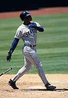 OAKLAND, CA - Ken Griffey Jr. of the Seattle Mariners bats during a game against the Oakland Athletics at the Oakland Coliseum in Oakland, California in 1998. (Photo by Brad Mangin)
