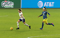 ORLANDO, FL - JANUARY 22: Emily Sonnett #14 dribbles away from Ingrid Guerra #14 during a game between Colombia and USWNT at Exploria stadium on January 22, 2021 in Orlando, Florida.
