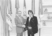 """Elvis Presley meeting Richard Nixon. On December 21, 1970, at his own request, Presley met then-President Richard Nixon in the Oval Office of The White House. Elvis is on the right. Waggishly, this picture is said to be 'of the two greatest recording artists of the 20th century'. The Nixon Library & Birthplace sells a number of souvenir items with this photo and the caption, """"The President & the King.""""<br /> <br /> PHOTO : Ollie Atkins, chief White House photographer"""