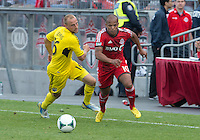 18 May 2013: Toronto FC forward Robert Earnshaw #10 and Columbus Crew defender/midfielder Eric Gehrig #16 in action during an MLS game between the Columbus Crew and Toronto FC at BMO Field in Toronto, Ontario Canada..The Columbus Crew won 1-0...