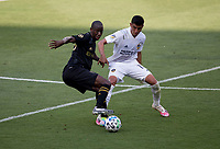 LOS ANGELES, CA - AUGUST 22: Bradley Wright-Phillips #66 of LAFC attempts to move past Joe Corona #15 of the Los Angeles Galaxy during a game between Los Angeles Galaxy and Los Angeles FC at Banc of California Stadium on August 22, 2020 in Los Angeles, California.