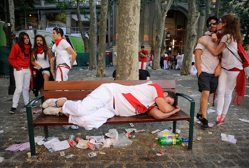A rebeller sleeps during the second San Fermin Festival´s day on July 8, 2013, in Pamplona, Basque Country. On each day of the eight San Fermin festival days six bulls are released at 8:00 a.m. (0600 GMT) to run from their corral through the narrow, cobbled streets of the old navarre town over an 850-meter (yard) course. Ahead of them are the runners, who try to stay close to the bulls without falling over or being gored. (Ander Gillenea / Bostok Photo)