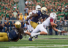 Sept. 26, 2015; Massachusetts quarterback Blake Frohnapfel  Lineman is sacked by lineman Sheldon Day in the second quarter at Notre Dame Stadium. (Photo by Barbara Johnston/University of Notre Dame)