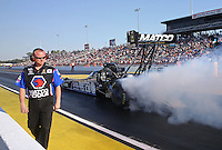 Mar. 15, 2013; Gainesville, FL, USA; NHRA crew member for top fuel dragster driver Antron Brown during qualifying for the Gatornationals at Auto-Plus Raceway at Gainesville. Mandatory Credit: Mark J. Rebilas-