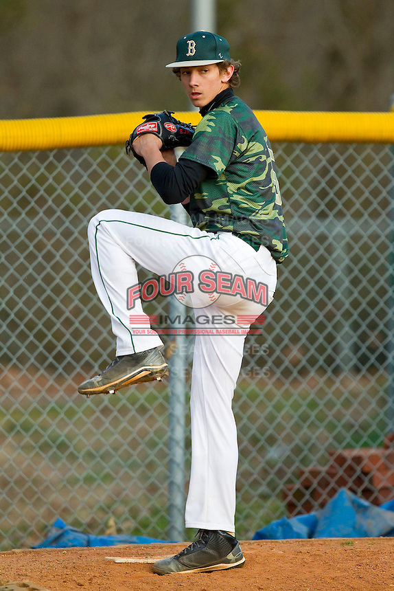 Hunter Harvey (5) of the Bandys Trojans warms-up prior to the game against the South Iredell Vikings at Bandys High School on March 22, 2013 in Catawba, North Carolina.  Hunter is the son of former Major League pitcher Bryan Harvey.  (Brian Westerholt/Four Seam Images)