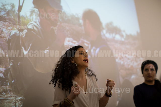 """Jenifer Shahin (One of the organisers of the event).<br /> <br /> London, 23/08/2016. Today, Palestinian photojournalist, activist and author of """"Roots Run Deep"""", Hamde Abu Rahma visited London - during his speaking tour - for a meeting at Valentine Place where he described his life, experience and work under the Israeli Occupation. Hamde Abu Rahma is from a village in the West Bank called Bil'in and he 'battled' for two years with the UK Visas and Immigration to be granted the visa to visit the United Kingdom.<br /> <br /> For more information about Hamde Abu Rahma please click here: http://www.hamdeaburahma.com/<br /> <br /> For more information about his UK Visa please click here: http://www.edinburghnews.scotsman.com/inspire-me/festivals/palestinian-photographer-denied-uk-entry-visa-1-3858573 & http://www.heraldscotland.com/news/14663592.Watch__Banned_Palestinian_journalist_finally_sets_foot_on_Scottish_soil_after_two_year_battle/"""