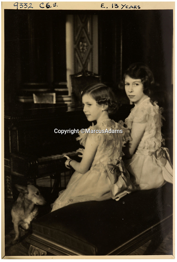 BNPS.co.uk (01202 558833)<br /> Pic: MarcusAdams/ChiswickAuctions/BNPS<br /> <br /> The Royal sisters at Buckingham Palace on the eve of WW2 - (Princess Elizabeth aged 13)<br /> <br /> Charming childhood photos of Princess Elizabeth and Princess Margaret have come to light, including a previously unseen image of the future Queen in a kilt.<br /> <br /> The portraits, taken by acclaimed British society photographer Marcus Adams, capture the future Queen from being a baby to her adolescence.<br /> <br /> The Queen Mother would often take her daughters to his central London studio where he would set up toys and props to keep them entertained