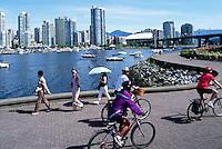 Vancouver, BC, British Columbia, Canada - City Skyline at False Creek, People cycling and walking on Seawall, Summer