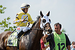 19 June 2010: Lady Rizzi and Alan Garcia before the Buckland Stakes race at Colonial Downs in New Kent, Va. Lady Rizzi is owned by Benchmark Racing Stable, trained by Linda Rice