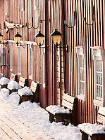 The facade with snow covered benches at Polarmuseet, the Polar Museum in Tromso, Norway
