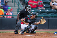 Hickory Crawdads catcher Tyler Sanchez (9) sets a target as home plate umpire Darrell Roberts looks on during the game against the Lexington Legends at L.P. Frans Stadium on April 29, 2016 in Hickory, North Carolina.  The Crawdads defeated the Legends 6-2.  (Brian Westerholt/Four Seam Images)