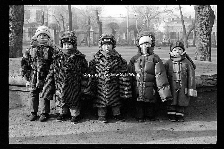 Chinese children pose for a photo during a visit to the Temple of Heaven in Beijing, China, 1985.