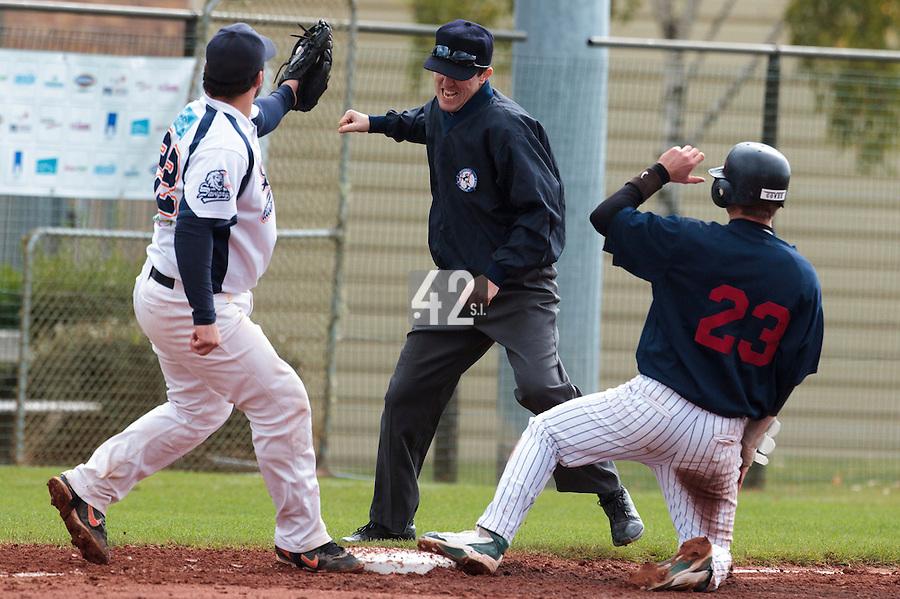 16 October 2010: Umpires Franck Lautier calls Aaron Hornostaj out during Rouen 16-4 win over Savigny, during game 1 of the French championship finals, in Savigny sur Orge, France.