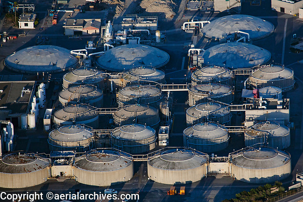 aerial photograph of storage tanks at the Orange County waste water treatment plant, Huntington Beach, Orange County, California