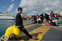 Pictured: A young boy rests at the port Sunday 28 February 2016<br /> Re: Hundreds of migrants have arrived from the Greek islands to Piraeus Port, Greece