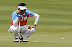 SUZHOU, CHINA - APRIL 17:  Lin Wen-tang of Taiwan lines up a put on the 8th green during the Round Three of the Volvo China Open on April 17, 2010 in Suzhou, China. Photo by Victor Fraile / The Power of Sport Images