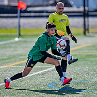 9 April 2021: University of Vermont Catamount Soccer Goalkeeper Edgar Vargas, a Sophomore from Yakima, WA, and and fellow Goalkeeper Nate Silveira, a Senior from East Providence, RI, warm up prior to facing the University of New Hampshire Wildcats at Virtue Field in Burlington, Vermont. The Catamounts fell to the visiting Wildcats 2-1 in America East, Division 1 play. Mandatory Credit: Ed Wolfstein Photo *** RAW (NEF) Image File Available ***
