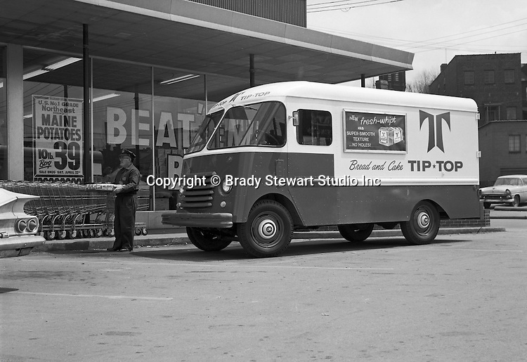 Client: J.B.E. Olson Corporation<br /> Ad Agency: none<br /> Contact:<br /> Product: Olson Kurbmasters<br /> Location: Thorofare Supermarket in Pittsburgh<br /> <br /> Route driver delivering Tip Top Bread to the Thorofare Super Market.  On location photography for JBE Olson Company, the step van manufacturer.  Ward Baking used Olson Kurbmasters which were popular parcel delivery vans in the 1960s. They were built using Ford P-series chassis with a slanting engine compartment and slab-sided front end. Kurbmaster is still copied today by many step-van manufacturers.