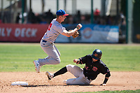 Stockton Ports shortstop Kevin Merrell (19) attempts to turn a double play ahead of Mark Karaviotis (24) during a California League game against the Visalia Rawhide at Visalia Recreation Ballpark on May 9, 2018 in Visalia, California. Stockton defeated Visalia 4-2. (Zachary Lucy/Four Seam Images)