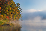 Devil's Lake State Park, WI<br /> Morining fog over the calm surface of Devil's lake with reflections of the autumn forest on the lake shore