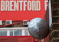 A helium balloon is attached to the outside of the main gates with the words, Thank You for a Top Top Season from Bee Positive during Brentford vs Barnsley, Sky Bet EFL Championship Football at Griffin Park on 22nd July 2020
