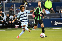 KANSAS CITY, KS - MAY 9: Gianluca Busio #10 Sporting KC passes the ball during a game between Austin FC and Sporting Kansas City at Children's Mercy Park on May 9, 2021 in Kansas City, Kansas.