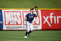 Mississippi Braves Connor Lien (5) catches a fly ball during a Southern League game against the Jacksonville Jumbo Shrimp on May 5, 2019 at Trustmark Park in Pearl, Mississippi.  Mississippi defeated Jacksonville 1-0 in ten innings.  (Mike Janes/Four Seam Images)