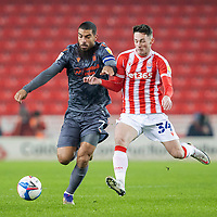 29th December 2020; Bet365 Stadium, Stoke, Staffordshire, England; English Football League Championship Football, Stoke City versus Nottingham Forest; Lewis Grabban of Nottingham Forest and Jordan Thompson of Stoke City chase a lose ball