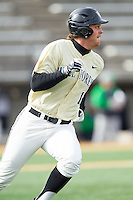 Joe Napolitano (12) of the Wake Forest Demon Deacons hustles down the first base line against the Marshall Thundering Herd at Wake Forest Baseball Park on February 17, 2014 in Winston-Salem, North Carolina.  The Demon Deacons defeated the Thundering Herd 4-3.  (Brian Westerholt/Four Seam Images)