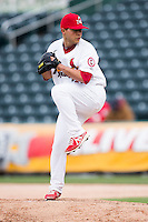 Richard Castillo #33 of the Springfield Cardinals winds up during a game against the Tulsa Drillers at Hammons Field on May 4, 2013 in Springfield, Missouri. (David Welker/Four Seam Images)