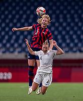 SAITAMA, JAPAN - JULY 24: Samantha Mewis #3 of the USWNT heads the ball over CJ Bott #4 of New Zealand during a game between New Zealand and USWNT at Saitama Stadium on July 24, 2021 in Saitama, Japan.