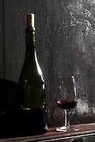 glass and bottle on a vat domaine du vissoux beaujolais burgundy france