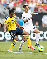 CHARLOTTE, NC - JULY 20: Dominic Thompson #60 and Jaime Baez #28 contest the ball during a game between ACF Fiorentina and Arsenal at Bank of America Stadium on July 20, 2019 in Charlotte, North Carolina.