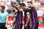 FC Barcelona's Luis Suarez (l) and Gerard Pique during La Liga match. September 24,2016. (ALTERPHOTOS/Acero)