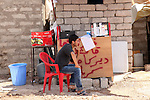 DOMIZ, IRAQ: A Syrian refugee sits by a makeshift stall selling cigarettes in the Domiz refugee camp...Over 7,000 Syrian Kurds have fled the violence in Syria and are living in the Domiz refugee camp in the semi-autonomous region of Iraqi Kurdistan...Photo by Ari Jalal/Metrography