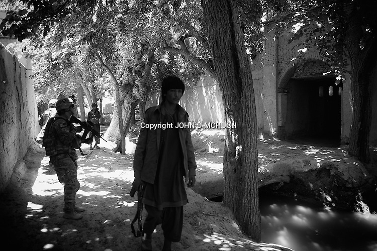 US troops from 1-38 Infantry move cautiously during a short lull in the fighting in Pay-E Moluk village in Panjwayi, Kandahar, 30 April 2013. The patrol was ambushed and turned into a five hour firefight. (John D McHugh)