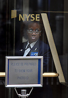 NEW YORK CITY - September 16, 2008: New York Stock Exchange security guard on duty at entrance to the Exchange looks out to the street during trading on Tuesday. Wall St.  Newsday/Ari Mintz  9/16/2008.