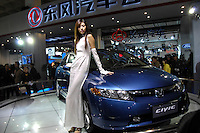 A model poses with a DongFeng Honda Civic at Beijing International Automobil Exhibition in Beijing, China..