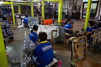 Yogyakarta, Java, Indonesia.  Batik Workshop.  Women Applying Wax to Designs on Batik Cloth.