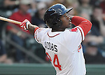Left fielder Brandon Jacobs (24) of the Greenville Drive hits a home run in the second inning of a game against the Augusta GreenJackets on April 7, 2011, at Fluor Field at the West End in Greenville, S.C. Photo by Tom Priddy / Four Seam Images