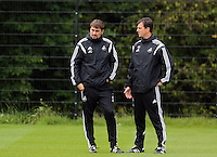 Pictured L-R: Josep Clotet (known as Pep) with Chris Llewellyn Youth U 21 coach. Thursday 14 August 2014<br /> Re: Swansea City FC training at Fairwood, south Wales, ahead of their first game of the Premier League season against Manchester United this coming Saturday.
