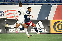 FOXBOROUGH, MA - OCTOBER 09: Damian Rivera #72 of New England Revolution II advances down the field as Modesto Mendez #15 of Fort Lauderdale CF comes in to tackle during a game between Fort Lauderdale CF and New England Revolution II at Gillette Stadium on October 09, 2020 in Foxborough, Massachusetts.