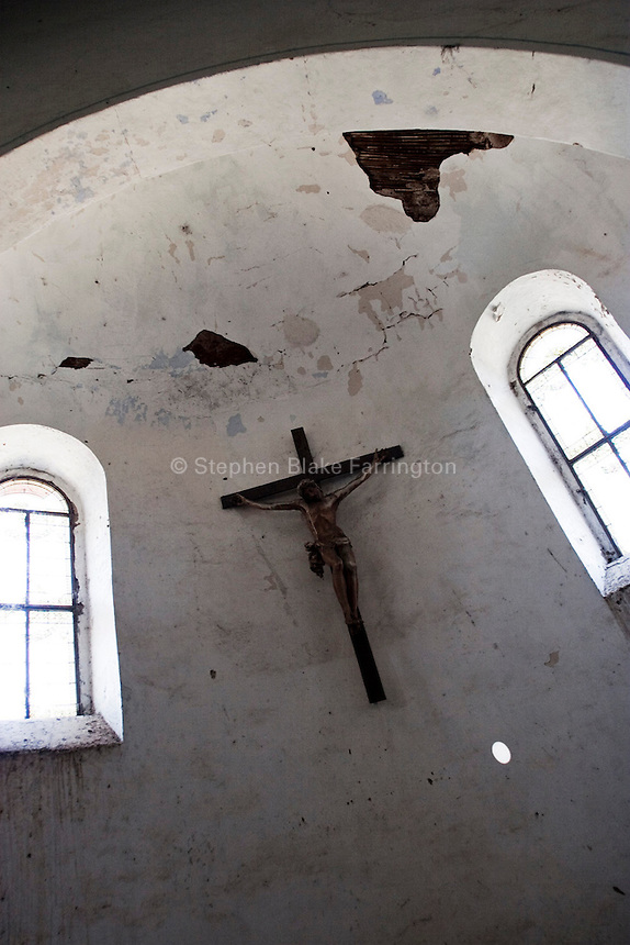 Africa, Sudan, Magwi County, Loa, Caught In Between, Northern Uganda/Southern Sudan - Inside the enormous Catholic cathedral in Loa. Loa is directly in the heart of this rebel conflict and takes on periodical attacks from the Lord's Resistance Army. The war in the region began in 1986 between the LRA and the Ugandan People's Defense Forces (UPDF). The LRA has reigned terror and carnage on Northern Uganda and Southern Sudan ever since. The ongoing war has significantly damaged the region and has left an ongoing burden on the local population. December 2005 © Stephen Blake Farrington