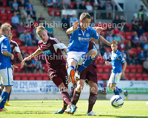 St Johnstone v Hearts...04.08.13 SPFL<br /> Gary McDonald battles with Kevin McHattie and Ryan Stevenson<br /> Picture by Graeme Hart.<br /> Copyright Perthshire Picture Agency<br /> Tel: 01738 623350  Mobile: 07990 594431
